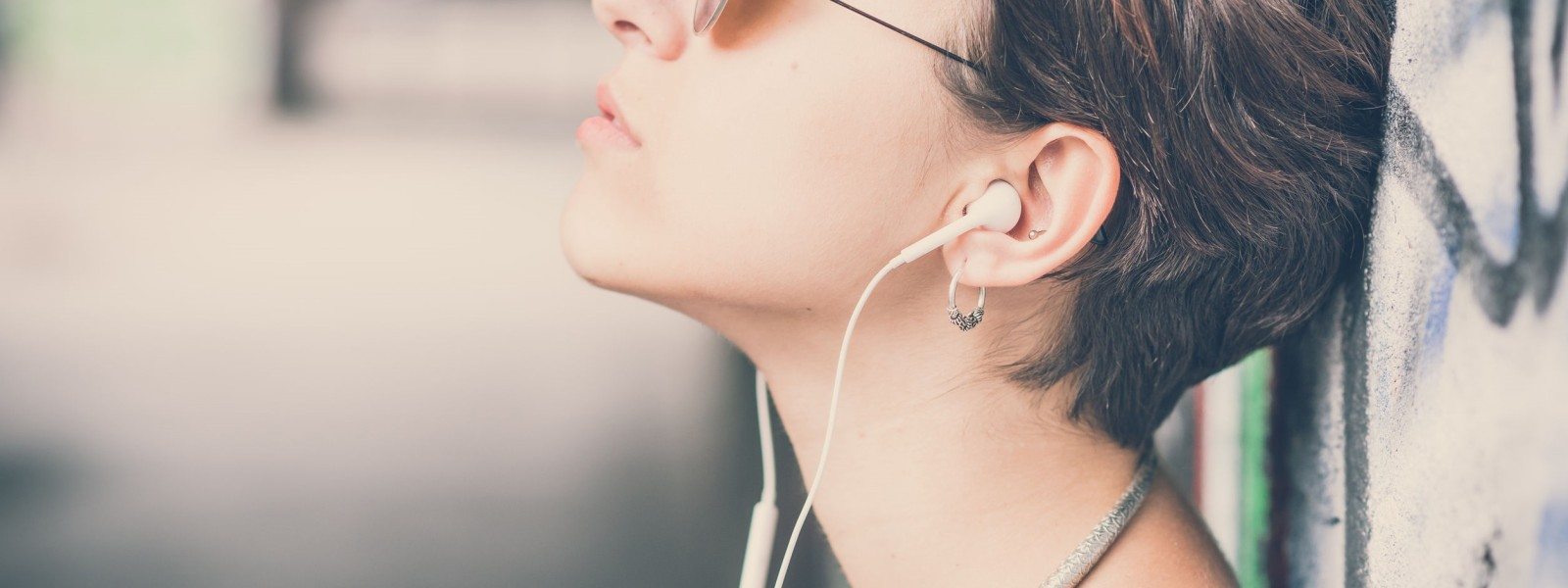 woman headphones wall