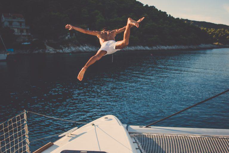 man jump ocean
